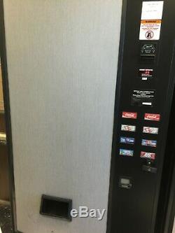1 Used M&M Vending Machine, 1 Snack Machine and 2 Soda Can Serpentine Machines