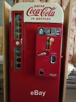 Beautiful restored 1957 Vendo H81 D Coca Cola machine. Most collectible