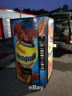 Soda Vending Machine. 10 Slot Selection. Nesquik logo. NICE