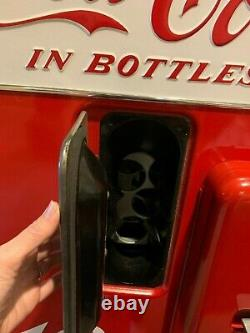 Vendo 39 vintage coke machine, fully restored inside and outside